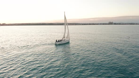 Thumbnail for Aerial View. Sailing Yacht on the Sea at the Sunset.