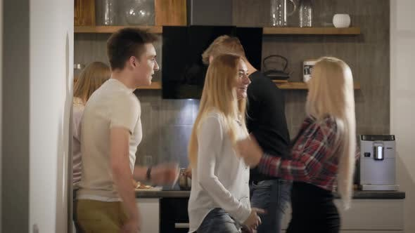 Thumbnail for Young People Dancing and Having Fun in Kitchen