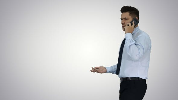 Thumbnail for Mature Man Talking On Cell Phone Passing By on gradient background.