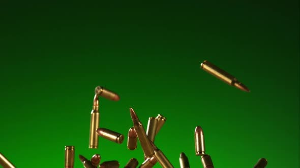 Bullets falling bouncing in ultra slow motion 1500fps on a reflective surface - BULLETS