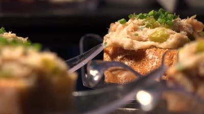 Bread with Gourmet Paste and Herbs on a Table - Closeup