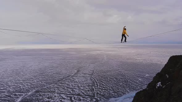 Thumbnail for Balance on the Horizon. Slackliner Is on a Tight Rope and Falls.