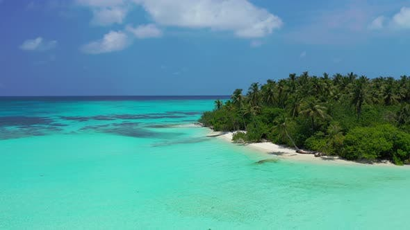 Thumbnail for Tropical aerial travel shot of a sandy white paradise beach and blue sea background in colourful 4K