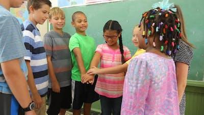 Group of classmates practice teamwork