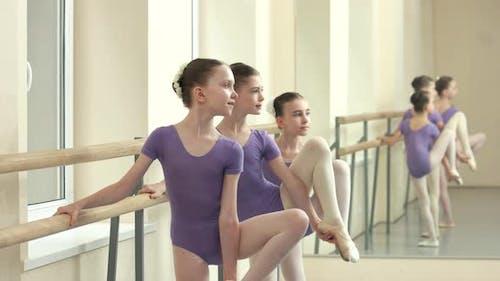 Young Ballerinas Training Their Flexibility