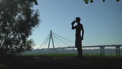 Sportman with Drink at the Open Air