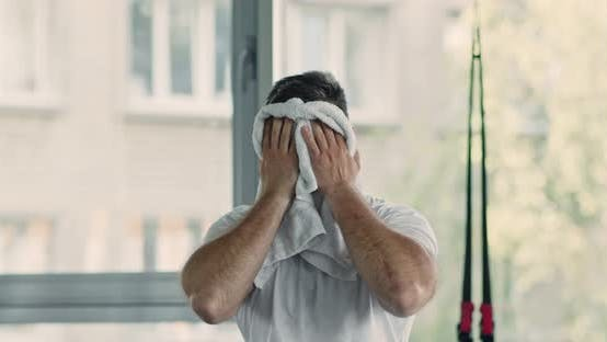 Thumbnail for Portrait of Tired After Intensive Training Man, Wiping His Sweat with Towel and Breathing