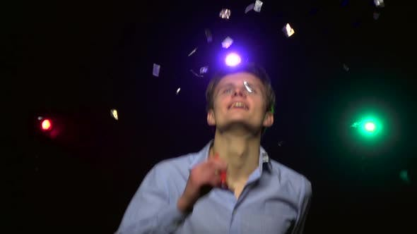 Man Throwing Confetti, Blowing Party Whistle, Dance. Close-up. Slow Motion