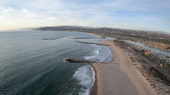 Thumbnail for Ventura California Surfers Knoll And Harbor Aerial Flyover Above Beach