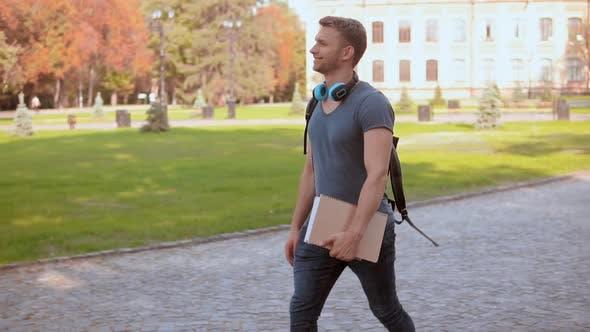 Thumbnail for Caucasian Student s Walks in City Park
