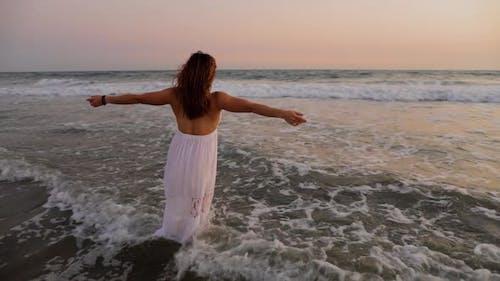 Beautiful Woman Enjoying The Beach