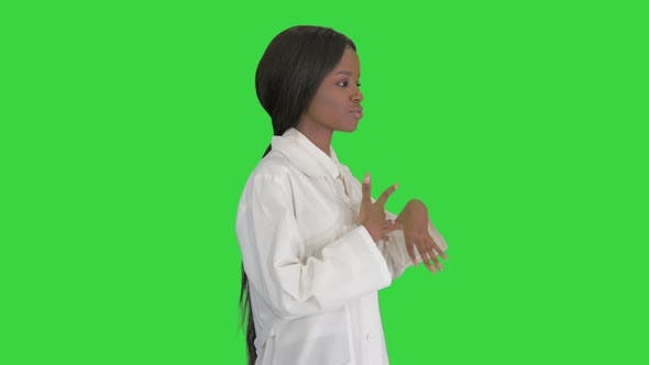 Thumbnail for Young African American Female Doctor Talking About Medical Care on a Green Screen, Chroma Key.
