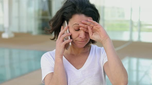 Thumbnail for Upset Middle Aged Woman Talking on Phone
