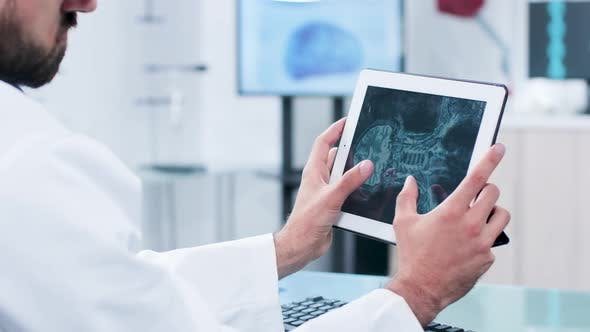 Thumbnail for Doctor Looking and Analyzing a X Ray on a Digital Tablet Pc Screen