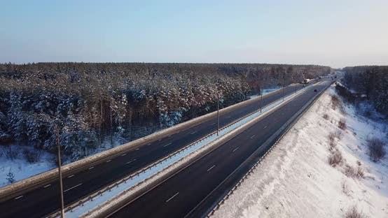 Thumbnail for View From Above of a Highway Road with Traffic Cars and Trucks on the Road in Winter