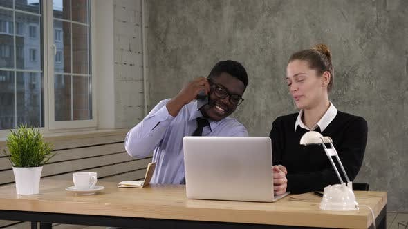 Thumbnail for Businesswoman Using Laptop And Businessman Making Call Team Work