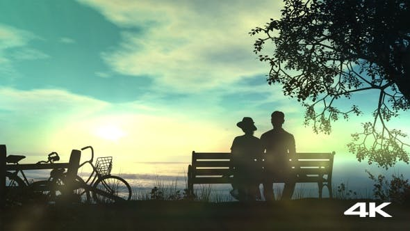 Thumbnail for Couple On A Bench Watching The Ocean 4K