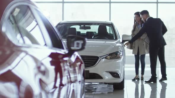 Thumbnail for Salesman Showing Car to Female Client