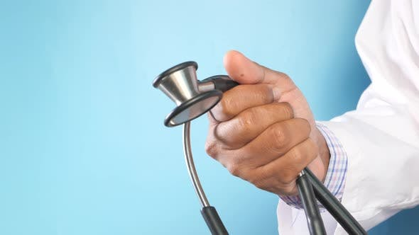 Thumbnail for Close Up of Doctor Hand Holding Stethoscope with Copy Space