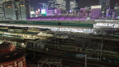 Timelapse Tokyo Railway Station with Purple Illuminated Roof