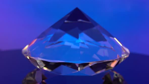 Thumbnail for Diamond Is Spinning and Shimmering with Blue Color. Blue Background.