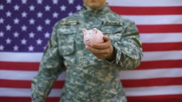 American Serviceman Putting Dollars in Piggy Bank, Social Benefits, Payment