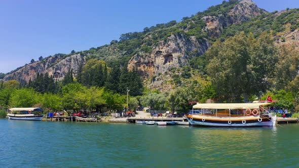 Thumbnail for Sailing Along the Dalyan River Overlooking the Lycian Tombs. Rock-cut Tombs in Myra