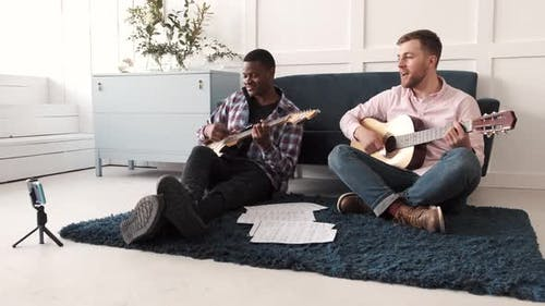 Two Friends Learn to Play Acoustic Guitar