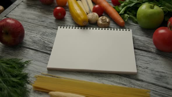Thumbnail for Empty Notepad Amidst Pasta Ingredients