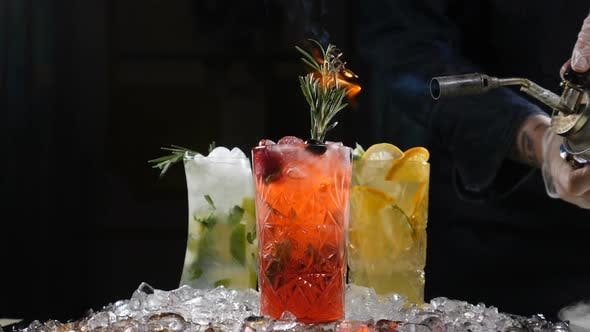Serving Fresh Coctails with Culinary Torch. Burning Rosemary. Slow Motion. Roasting of Rosemary for