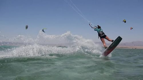 A young woman kiteboarding in Egypt.