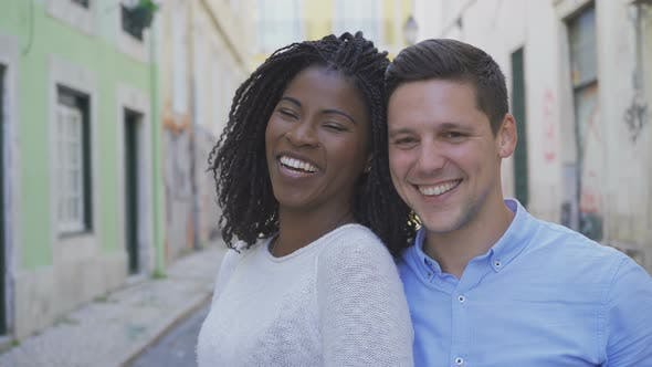 Thumbnail for Happy Multiracial Couple Looking at Camera