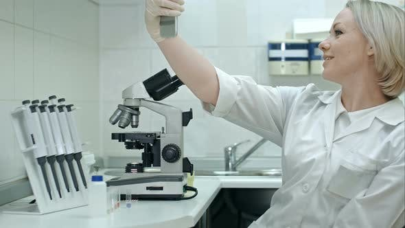 Thumbnail for Attractive Doctor Hav Taking Selfie Photo on Cellphone at Modern Laboratory