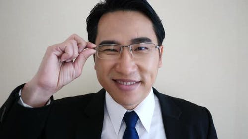 businessman facing camera. wearing glasses.