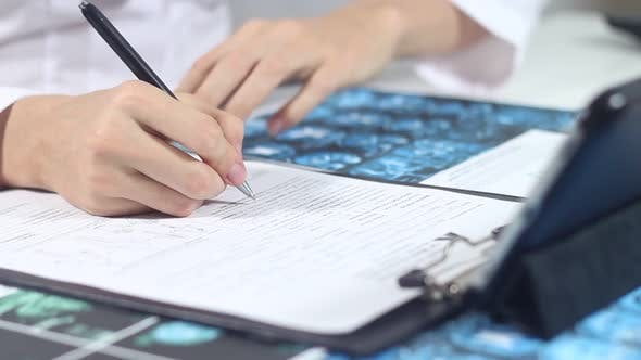 Thumbnail for Doctor Working In An Office With Medical Documents