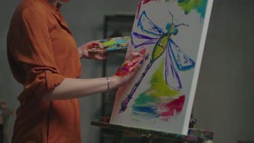 Woman Artist Fingerpainting Artwork in Studio