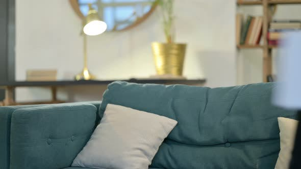 Thumbnail for Young African Man with Laptop Coming Back, Sitting on Sofa