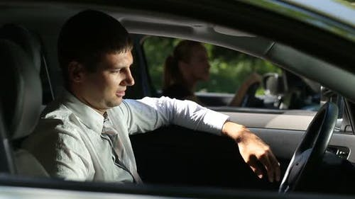 Frustrated Man Driving Car at Traffic Jam
