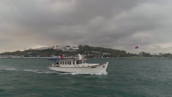 Thumbnail for Boat Sailing Bosphorus Topkapi Palace In Background Aerial View