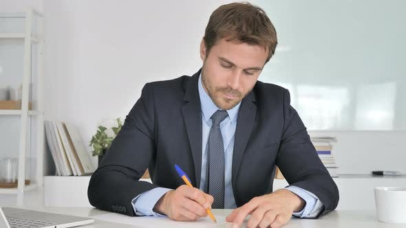 Thumbnail for Businessman Writing Documents in Office