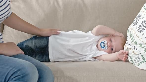Thumbnail for Sleepy Baby Lying on Sofa