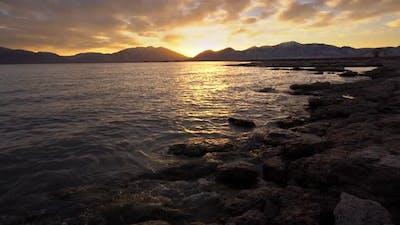 View of water hitting rocks at sunrise