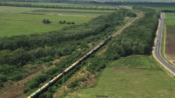 Thumbnail for A Freight Train Is Going Past Forests and Fields