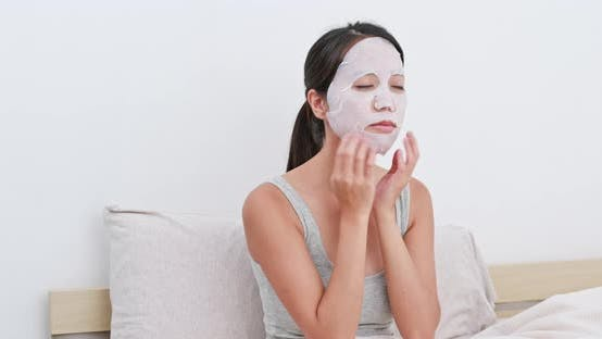 Thumbnail for Woman use of paper mask at home