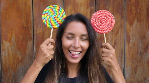 Thumbnail for Young Woman with Lollipops Making Minnie Mouse Ears From Candies
