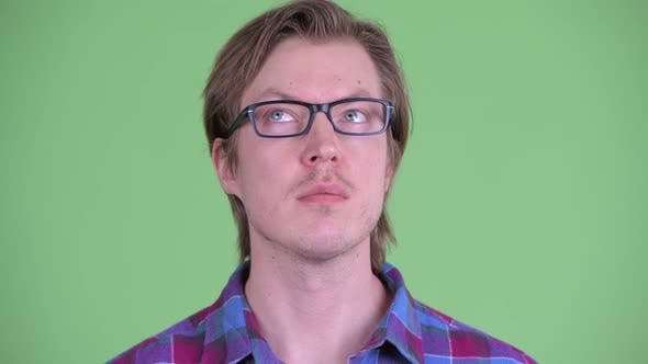 Cover Image for Face of Young Handsome Hipster Man Thinking and Looking Up