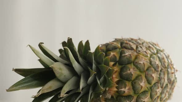 Thumbnail for Fresh Ananas comosus exotic fruit slow tilt 4K 2160p 30fps UltraHD tilting footage - Close-up of pin