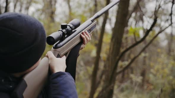 Thumbnail for Hunter Holding Hunting Rifle