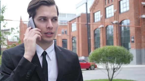 Thumbnail for Walk and Phone Talk by Businessman