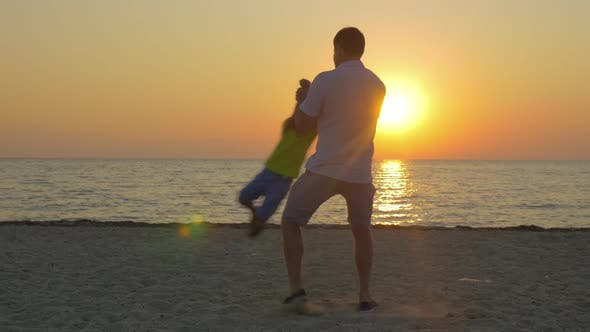 Thumbnail for Young Father and Little Son Having Fun on the Beach